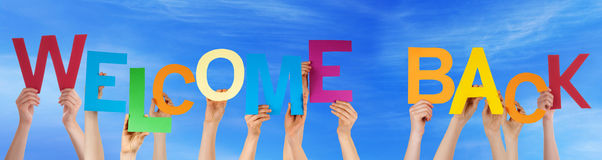 hands-hold-colorful-word-welcome-back-blue-sky-many-caucasian-people-holding-letters-characters-building-english-54035597